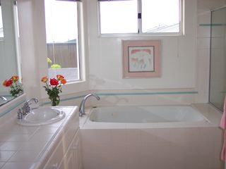 Ocean Beach condo photo - Master Bath with view of ocean from jetted tub