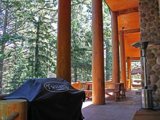 Sundance cabin photo - Back deck overlooking creek/ravine. Gas BB-Q, outdoor stone fireplace for smores