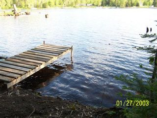 Winter house photo - a woodsy path leads to another dock to fish from or launch a kayak or canoe
