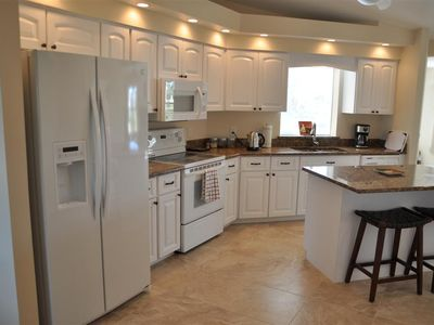 Fully equipped open plan kitchen with granite counter tops