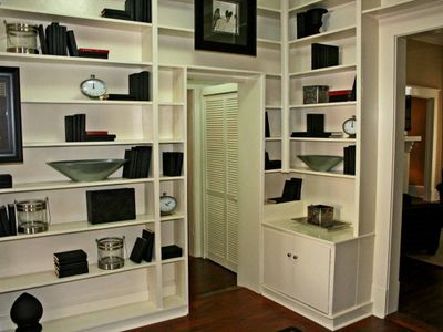 Rear entryway with unique built in bookshelves.