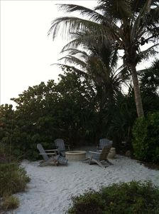 Beautifully landscaped firepit on beach area in back of Beach Destiny