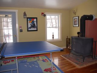 Wilmington house photo - Game room with TV, ping pong table, dart board, foolsball & wood stove.