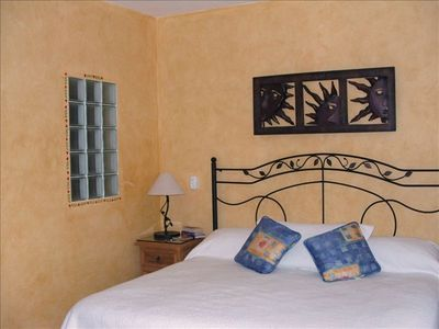 Local hand made wrought iron bed frames and carved occasional pieces