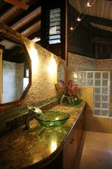 Haena house photo - Master Dual Sinks with marble and glass features