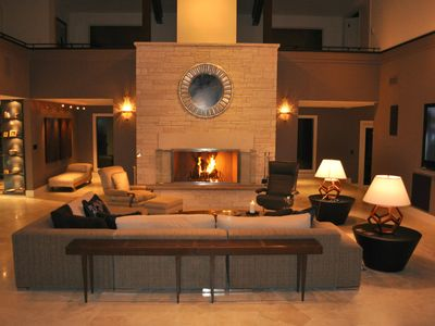 Great room with wood-burning fireplace and contemporary furnishings.