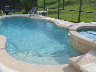 Legacy Park house photo - Pool and hot tub with built in sun shelf