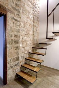 Original stone wall and stairs to the mezzanine level