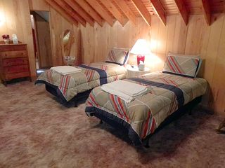 Upstairs Loft w/Two Twin Beds, Dresser, Walk-Through Closet, and Full Bathroom.