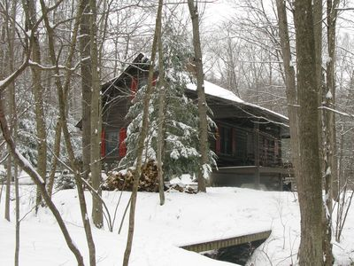 A winter wonderland, firewood keeps the cabin cozy and warm.