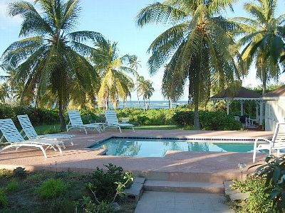 Nisbet Beach villa rental - View from the porch. Pool and gazebo with ocean views.