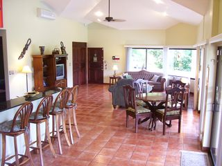 Playa Hermosa house photo - Open kitchen and living area with 15' vaulted ceilings. Floor to ceiling windows