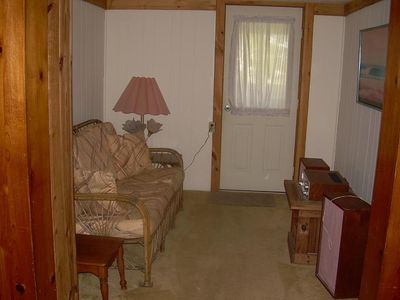 reading rm off of living rm-leads out to enclosed back deck area w/ picnic table