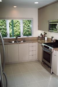 Kitchen featuring a stainless steel gas range and microwave.