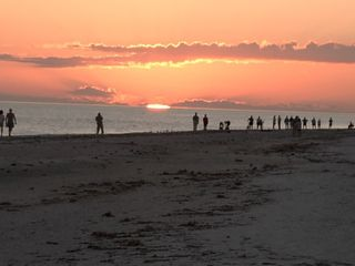 Sanibel Island condo photo - Another Day in Paradise sunset on beach in front