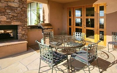 A gas Bar-B-Q and fireplace make this covered patio ideal for outdoor dining.