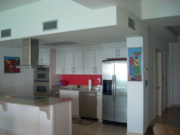 Full kitchen with stainless steel Kitchenaide appliances and granite countertops