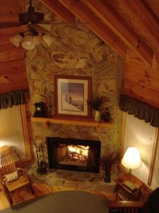 View of living area & wood-burning fireplace
