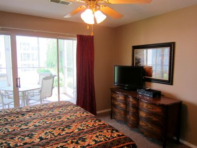 Branson condo rental - The master bedrooms at Meadow Brook Resort walk out to the screened porch.