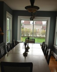 Three Oaks house photo - Xtra long dining table,comfortably seats 8. Easy access to kitchen.