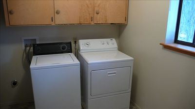 Complete laundry room downstairs