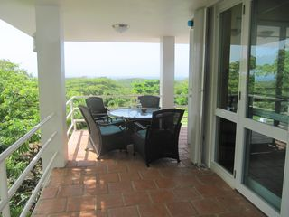 Vieques Island house photo - Upstairs outdoor dining.