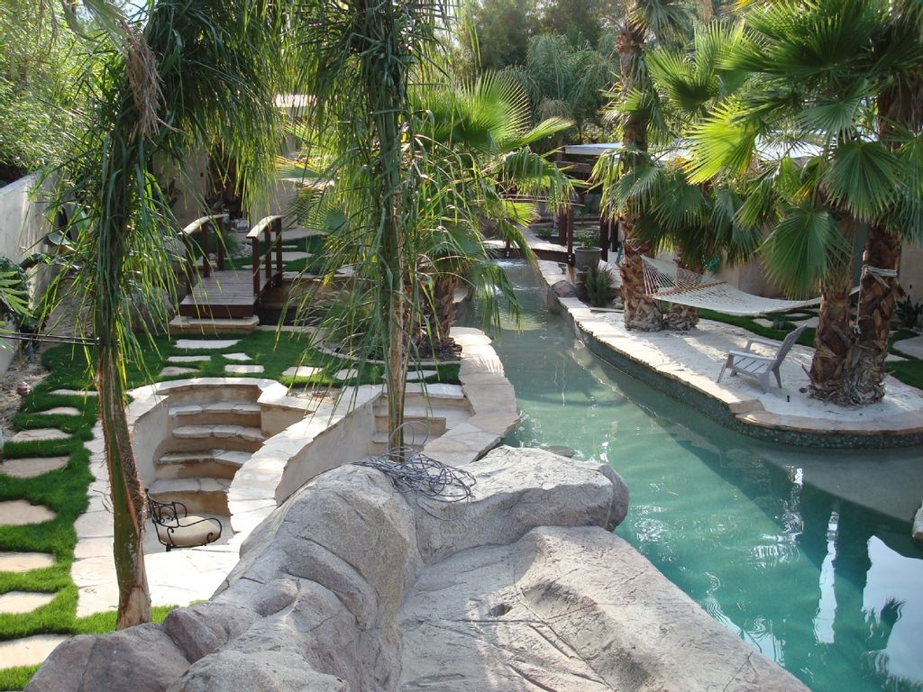 Tropical Villa Pool With Grotto Slide Vrbo