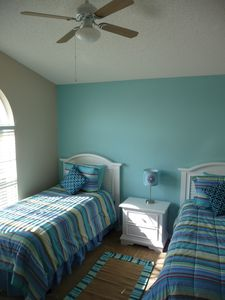 Two quality twin beds, ceiling fan, dresser.