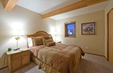 Two additional good size bedrooms have queen beds and TV