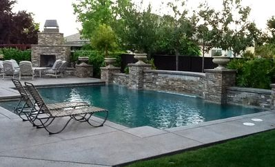 Luxury Living! Sparkling Pool! Waterfalls! Outdoor Fireplace!