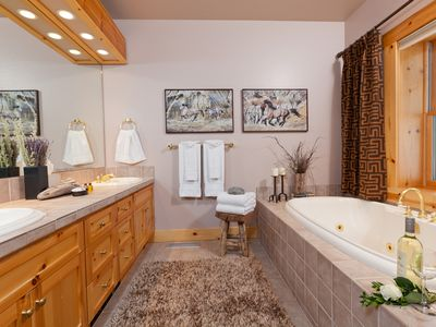 Master bath twin sinks, large walk-in shower, resort spa quality bath & towels