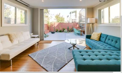 Modern, spacious tri-level house with roof deck views, garden, and parking