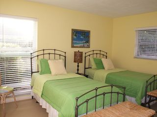 Vacation Homes in Marco Island house photo - Guest Bedroom - Great for the kids or additional Guests! Sunny garden view.