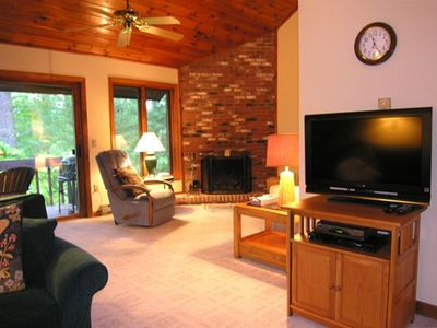 L-shaped living room, fireplace, HD wide-screen TV