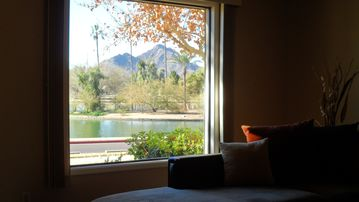 Downtown Scottsdale townhome rental - Living room facing out to the park with a view of Camelback Mountain.