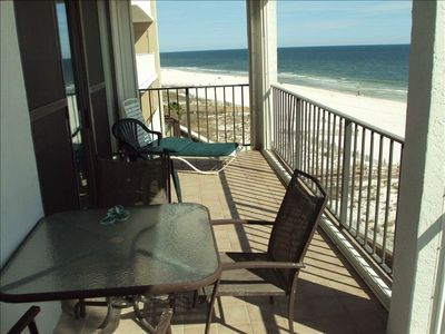 Enjoy relaxing on this 5th floor balcony overlooking the white, sandy beach!