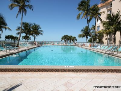 Large heated beach front pool with lots of lounge chairs.