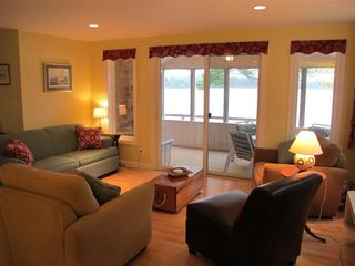 Washington house photo - Comfy living room with sofa bed and views of lake through porch