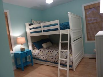 Bedroom with full bunk beds and a twin pull out trundle bed.