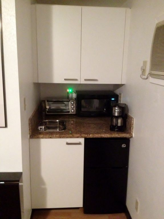Kitchenette; Mini-Fridge, Microwave, Toaster oven, Coffee pot, Induction Burner