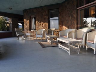 Newport chalet photo - Front porch. Great for enjoying a beverage while looking at the water.