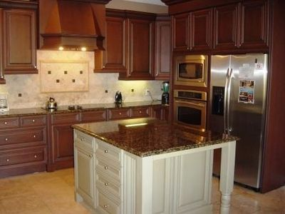 incredible kitchen with custom cabinets, exotic granites and built ins