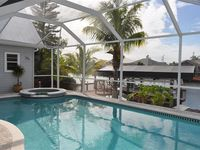 Beautiful 5/3 villa with heated saltwater pool+spa, 24ft boat, bikes, fishing