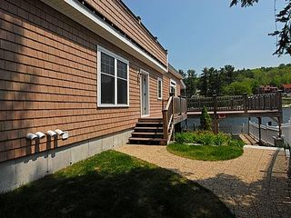 Private landscaped yard - Alton Bay condo vacation rental photo