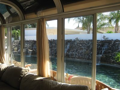Sun room view of the pool.