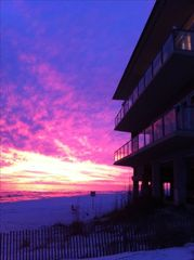 Inlet Beach house photo - sunset from beach side. Glass rails make your view from the home very dramatic