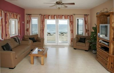 Spacious living room with walk-out directly to beach