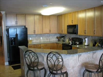Fully Furnished Gourmet Kitchen with granite