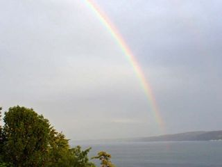 Camano Island house photo - Yes, it's true! Guests filmed this rainbow from the deck!