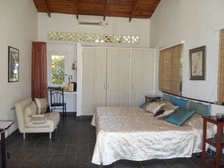 Playa Palmar house photo - Second bedroom - the front glass dors look out on garden and ocean